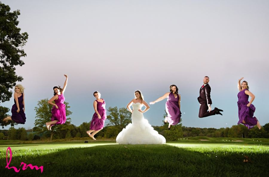bridesmaids jumping with bride