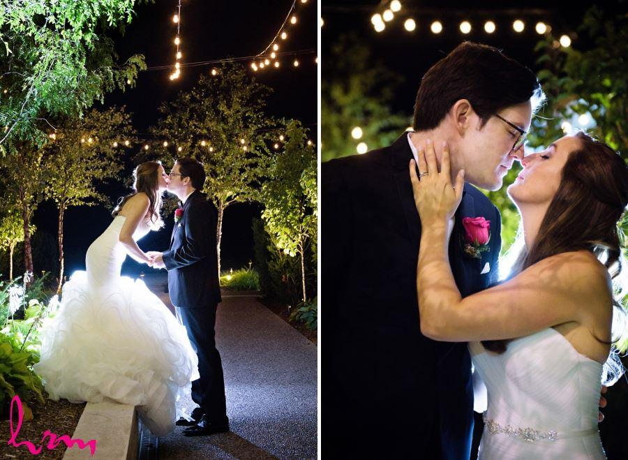 bride and groom under lights