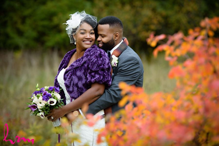 bride and groom with fall leaves
