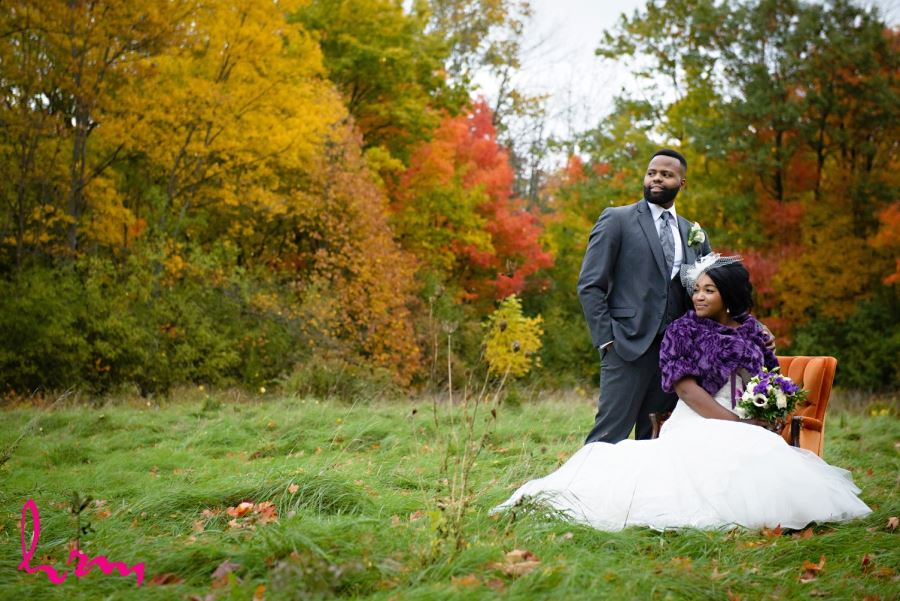 bride and groom with autumn coloured trees