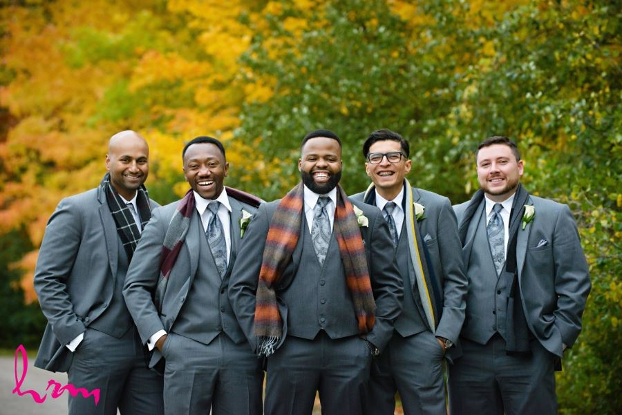 groomsmen and groom with scarves