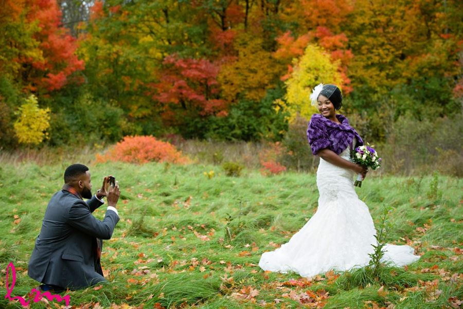 groom taking picture of bride