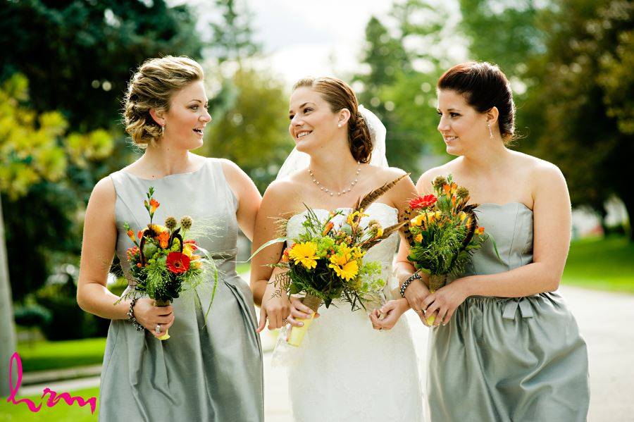 bride outside in ontario with wild flower bouquet