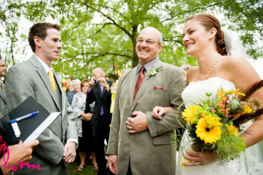 groom seeing bride walking down aisle at fanshawe pioneer village