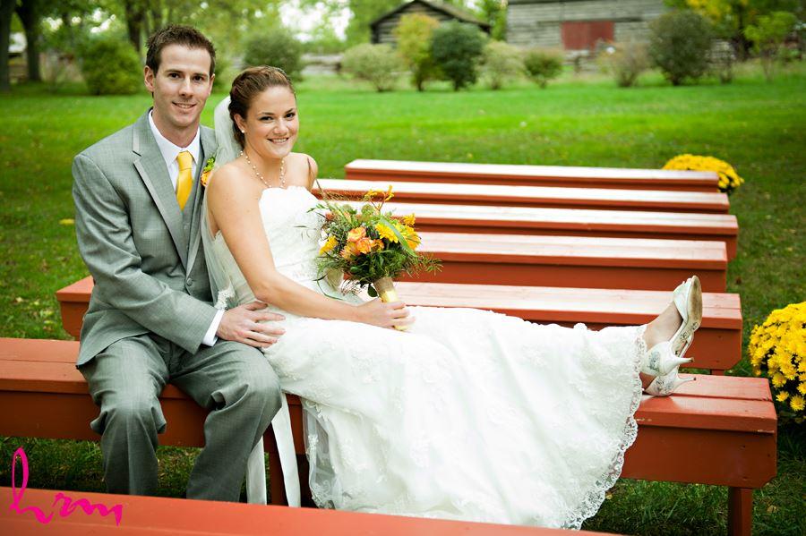 fanshawe pioneer village wedding party bride and groom kiss