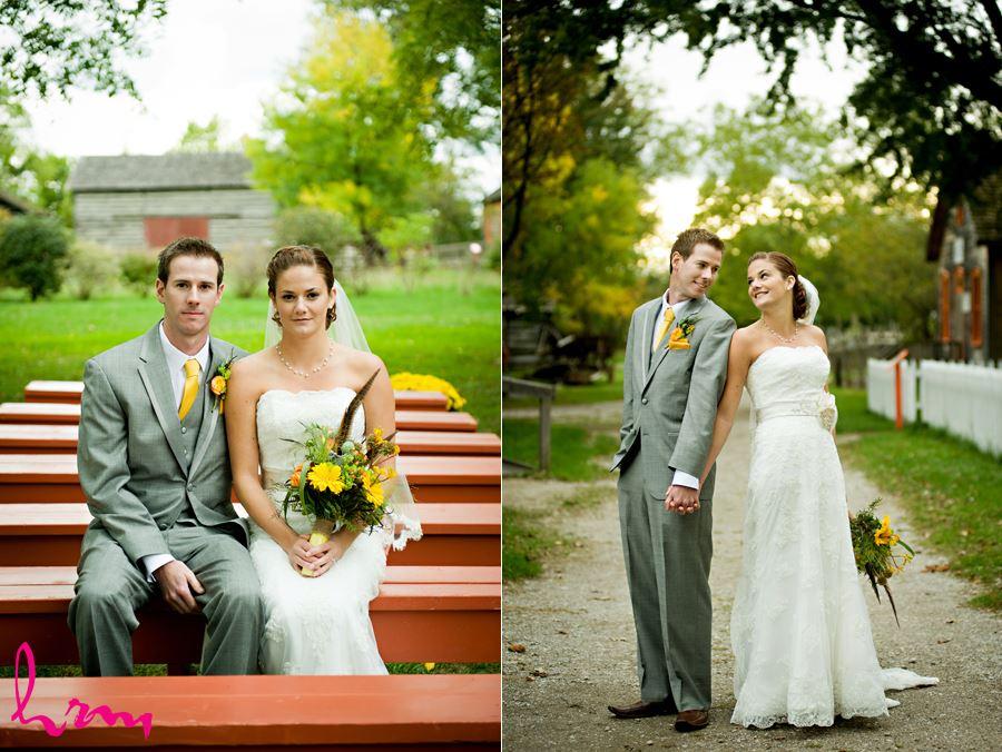 bride and groom sitting on red bench at fanshawe pioneer village