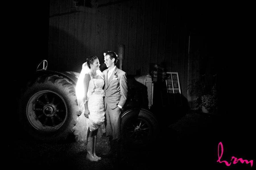 bridge and groom night time with vintage john deere tractor