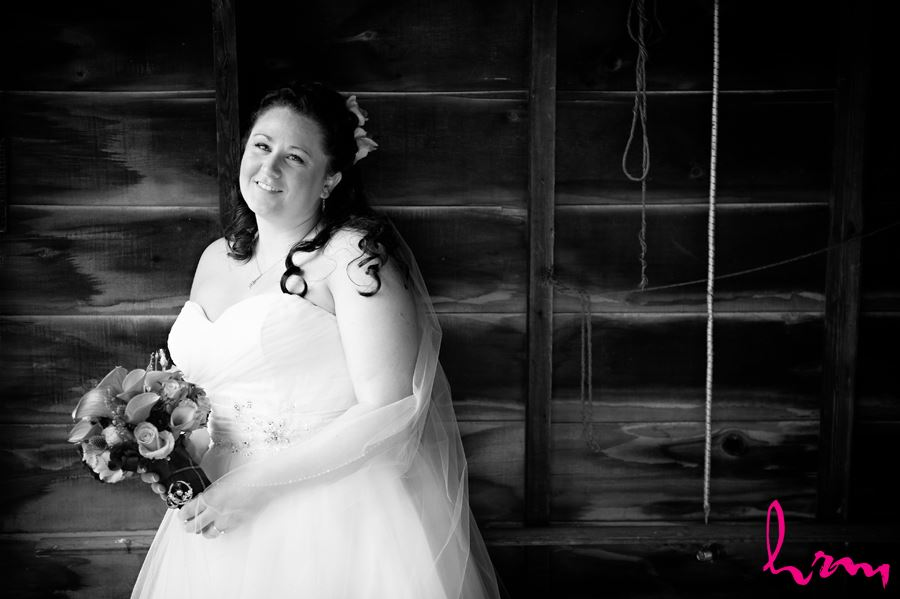 portrait of bride before ceremony against wood