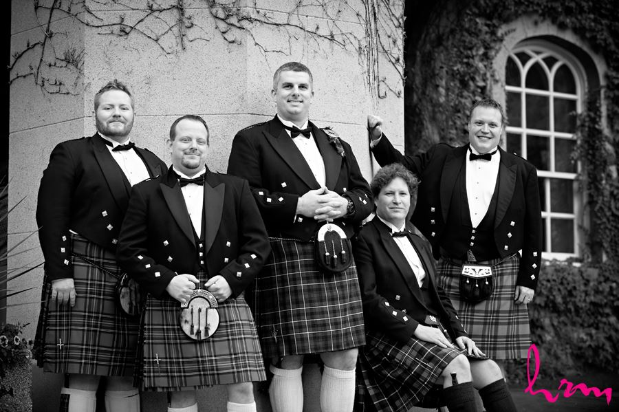 groom with his groomsmen with kilts outside the old courthouse