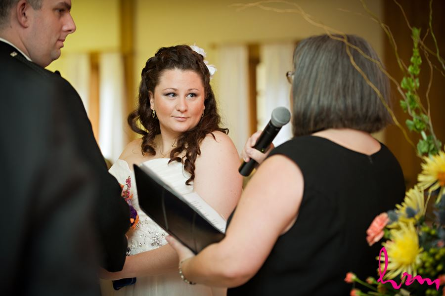 bride listening to officant speak at ceremony