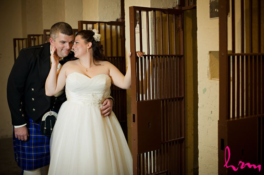 bride and groom in the old jail cell at the old court house