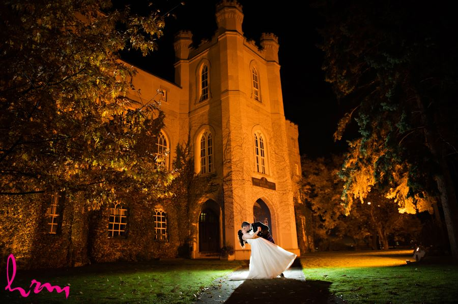 dreamy night time bride and groom dip at the old court house in london ontario