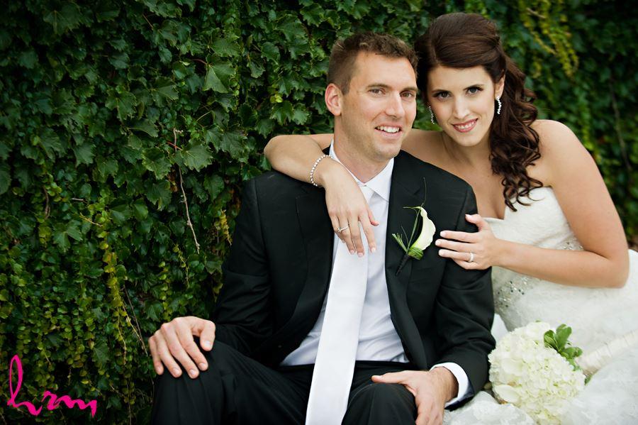 bride and groom sitting in london ontario