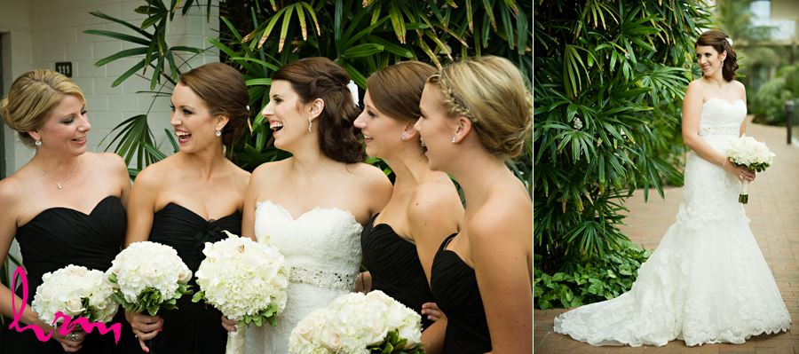 bride with bridesmaids laughing together