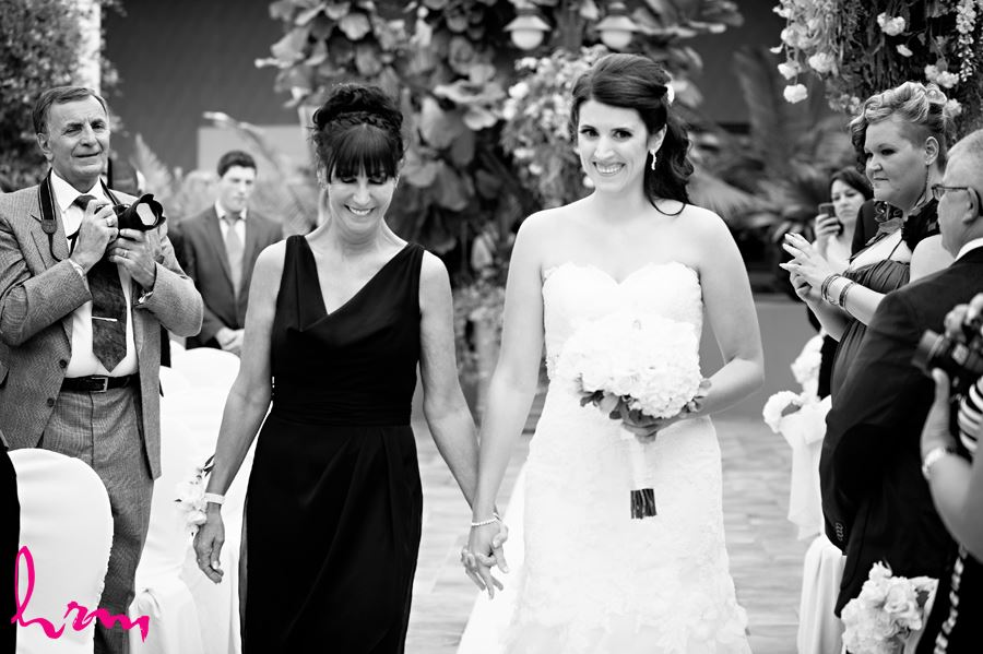 bride walking down aisle with mom