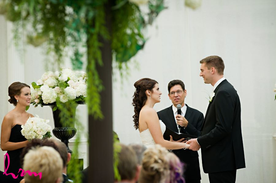 bride and groom saying vows to each other at ceremony