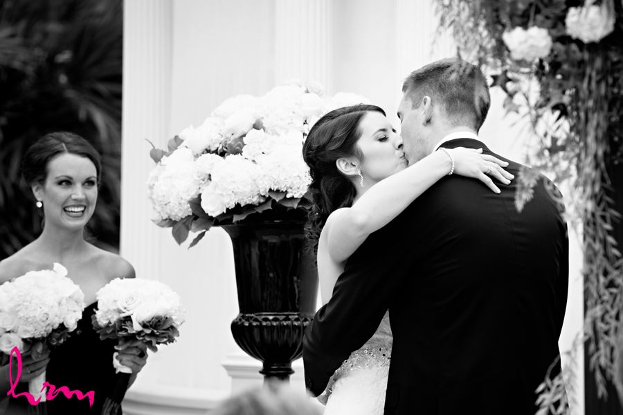 bride and groom first kiss at ceremony in the lamplighter inn