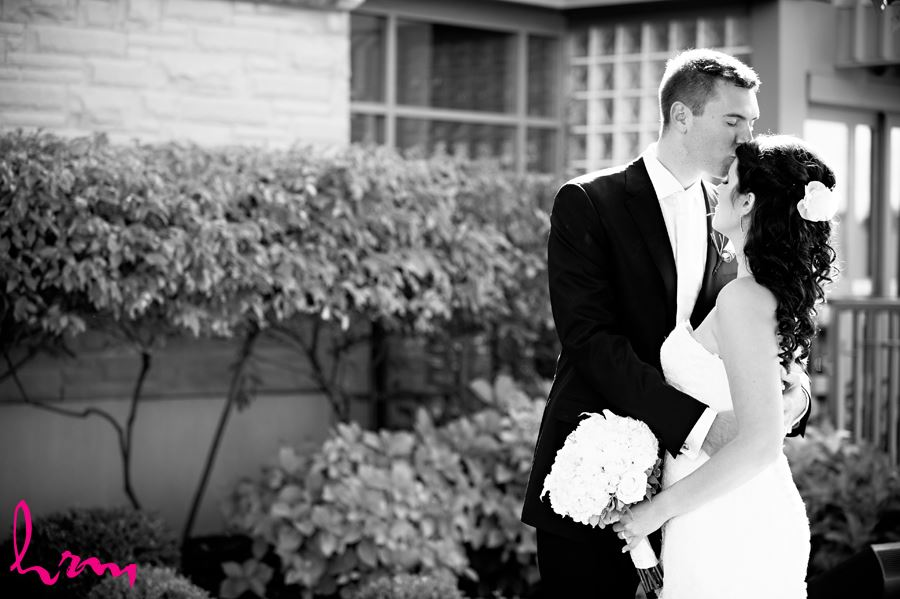 bride and groom black and white outside kiss