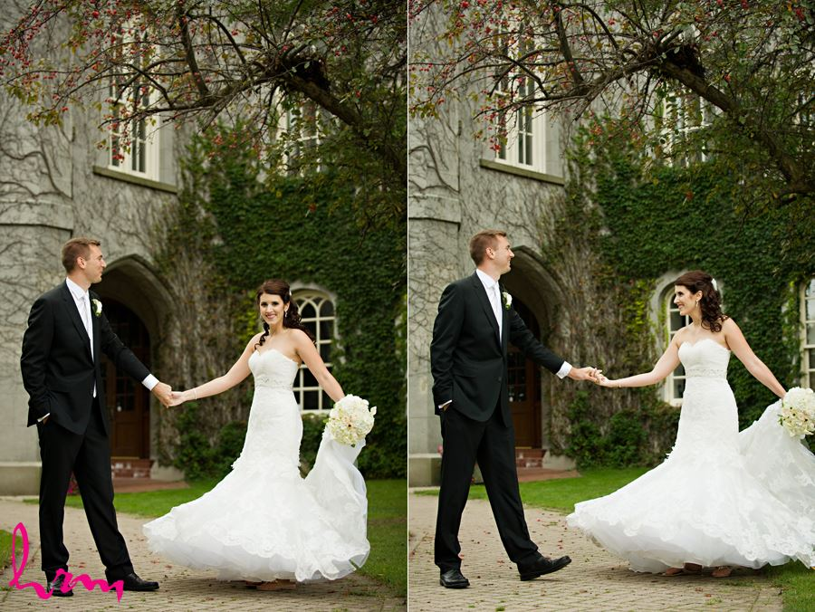bride and groom spinning outside old courthouse in london ontario