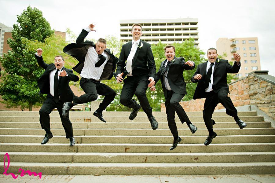 groom and groomsmen jumpming