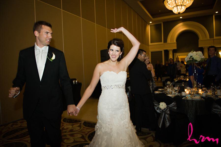 bride and groom enter reception room