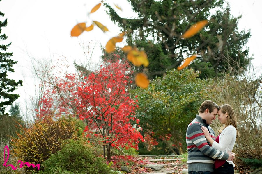 cute couple in fall scene smiling in toronto ontario