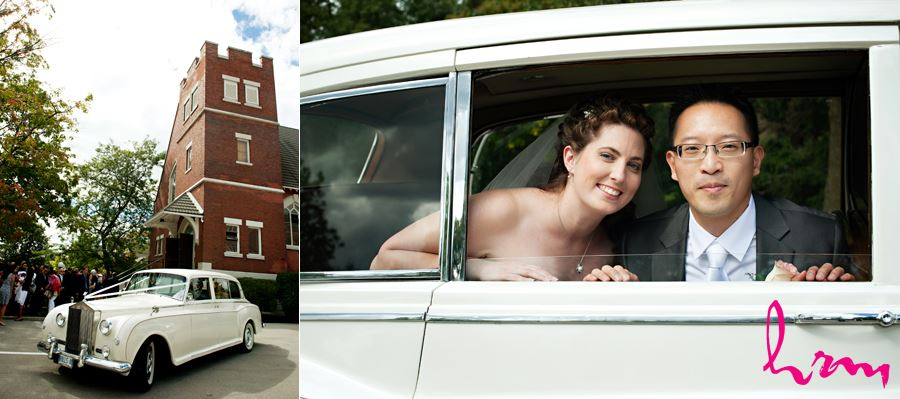 bride and groom in vintage rolls royce looking out