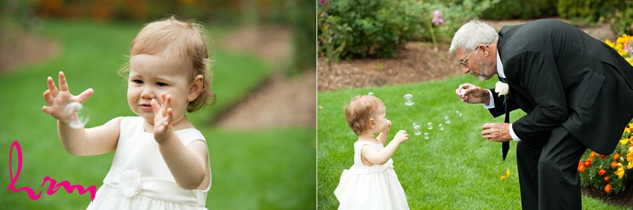 grandparent playing with grandchild with bubbles at wedding