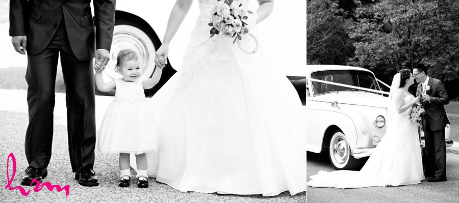 flower girl holding hands with bride and groom