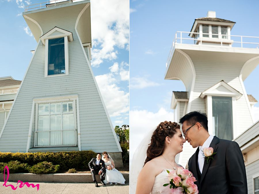 bride and groom enjoying a moment in front of light house