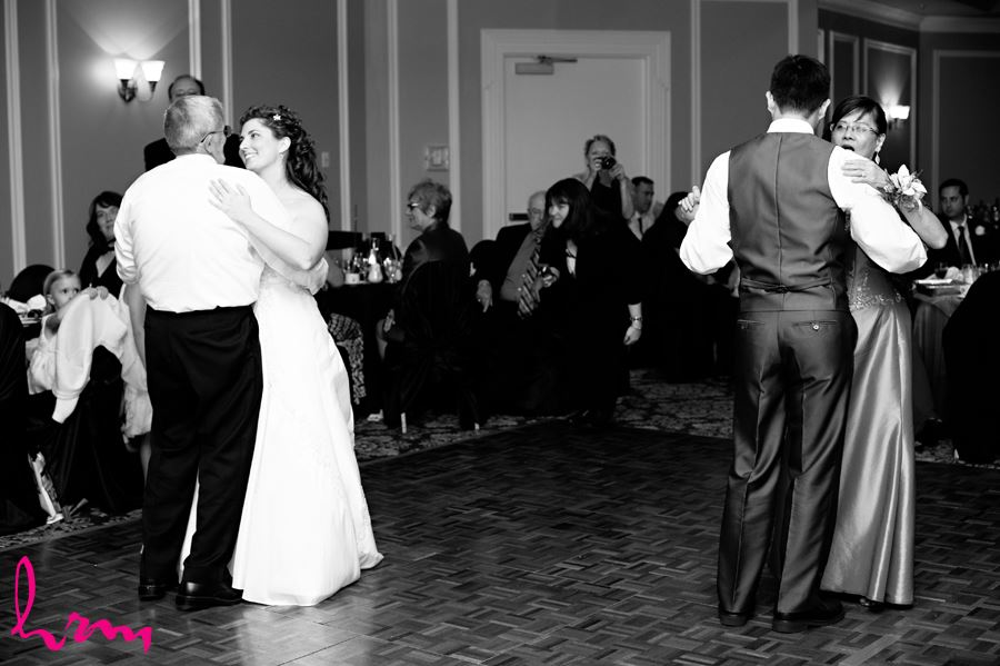 parent dances with father daughter and mother son