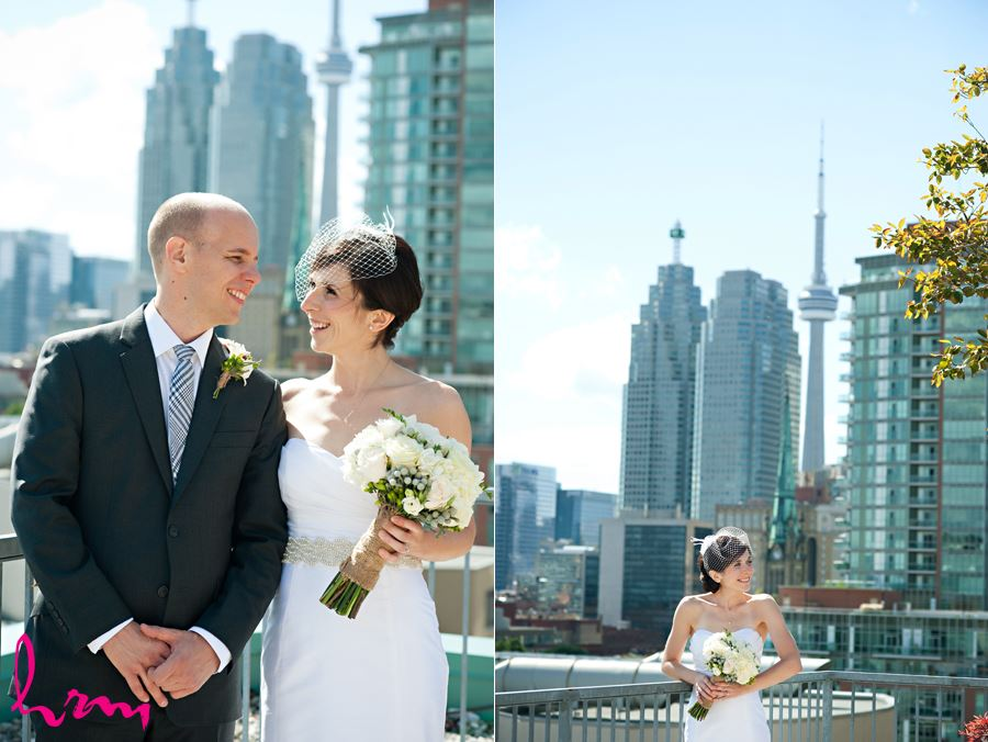 bride and groom with cn tower laughing