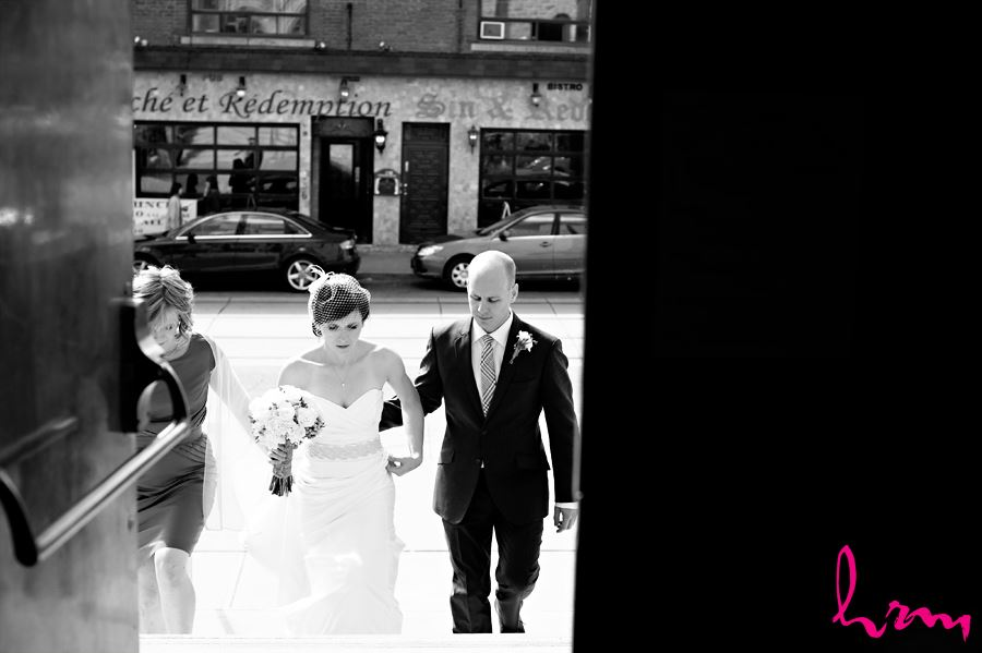 black and white bride and groom walking inside