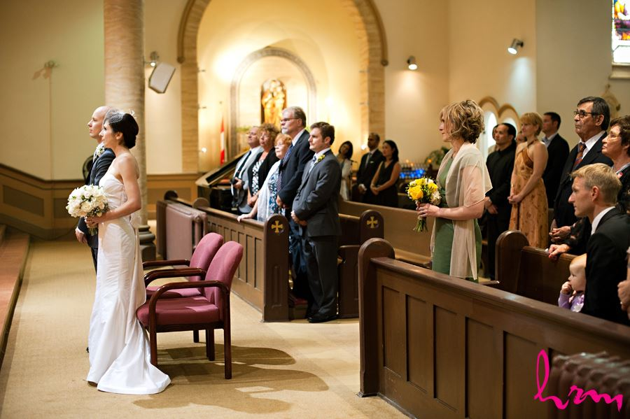 bride and groom in church with guest