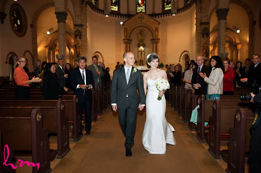 bride and groom walking down aisle after getting married