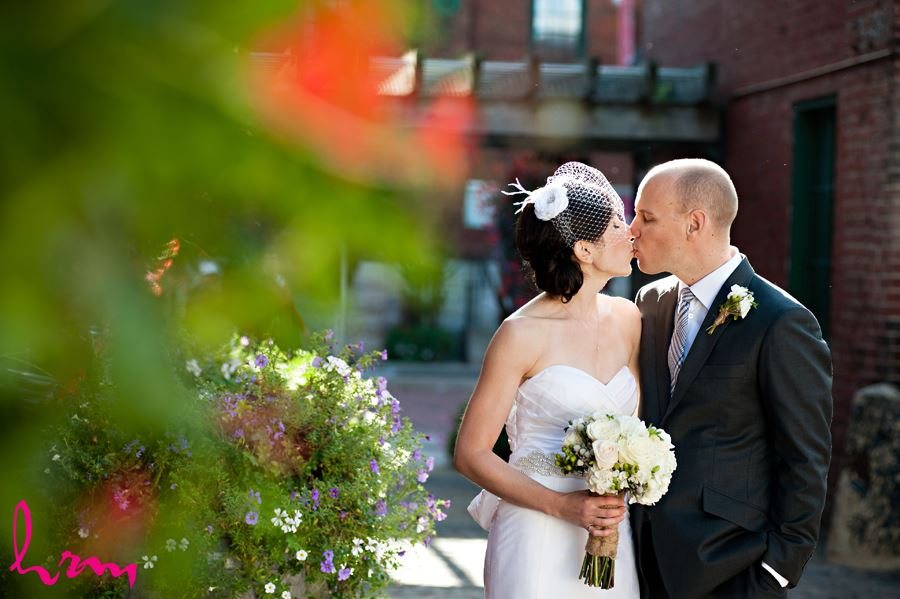 bride and groom kissing in the distillery district