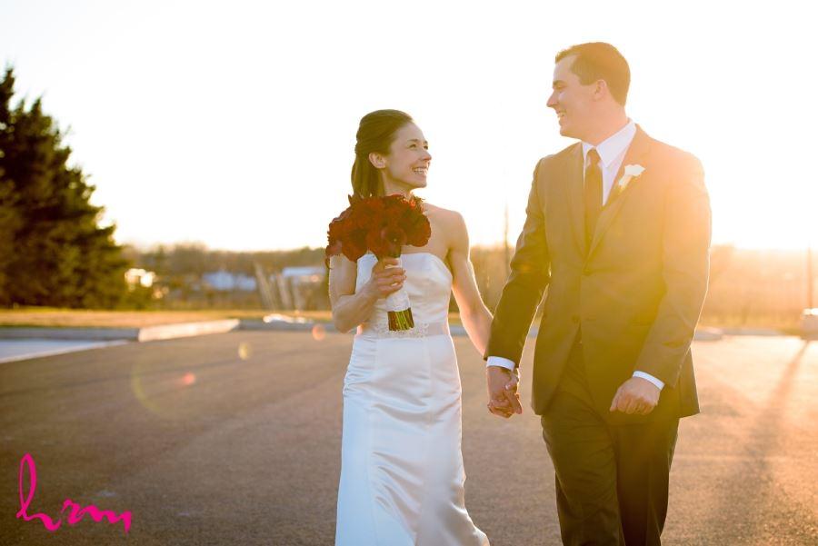 Bride and groom walking in sunlight beamsville ontario niagara area wedding