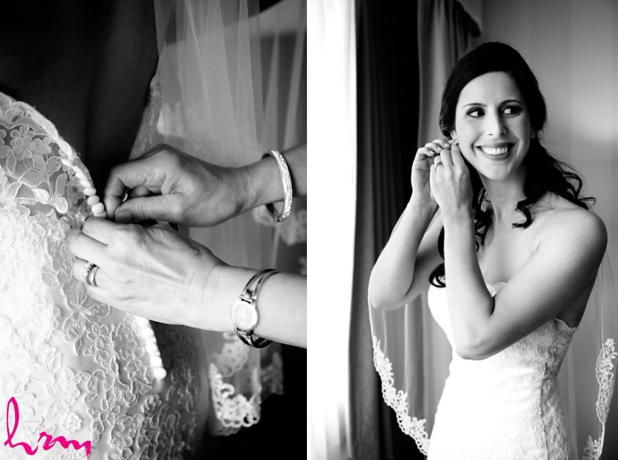 bride putting on earrings and putting on dress