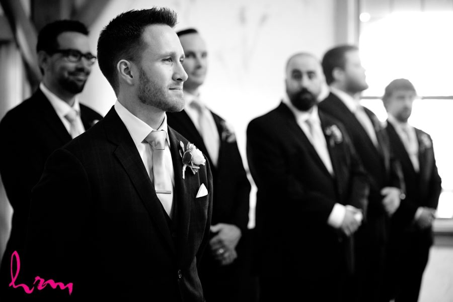 groom standing with groomsmen during ceremony