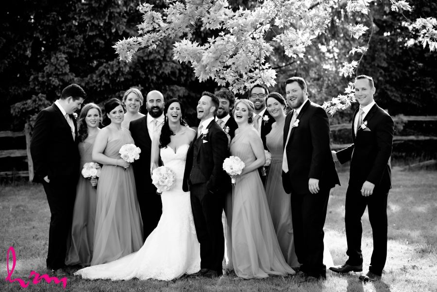 wedding party laughing outside