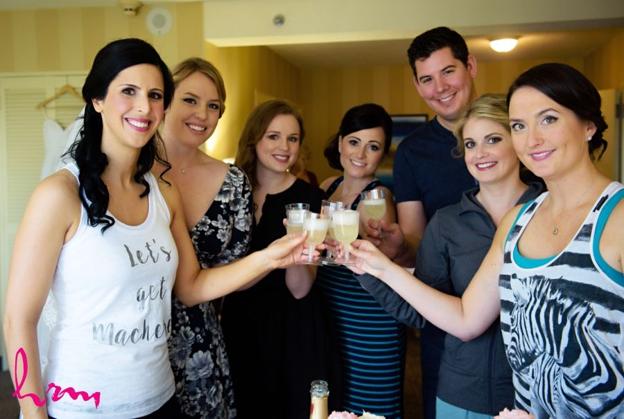 bride drinking champagne with bridesmaids