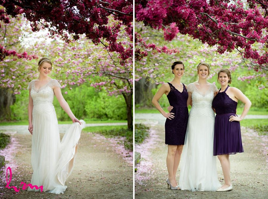 bride and bridesmaids with pink blossoms on tree