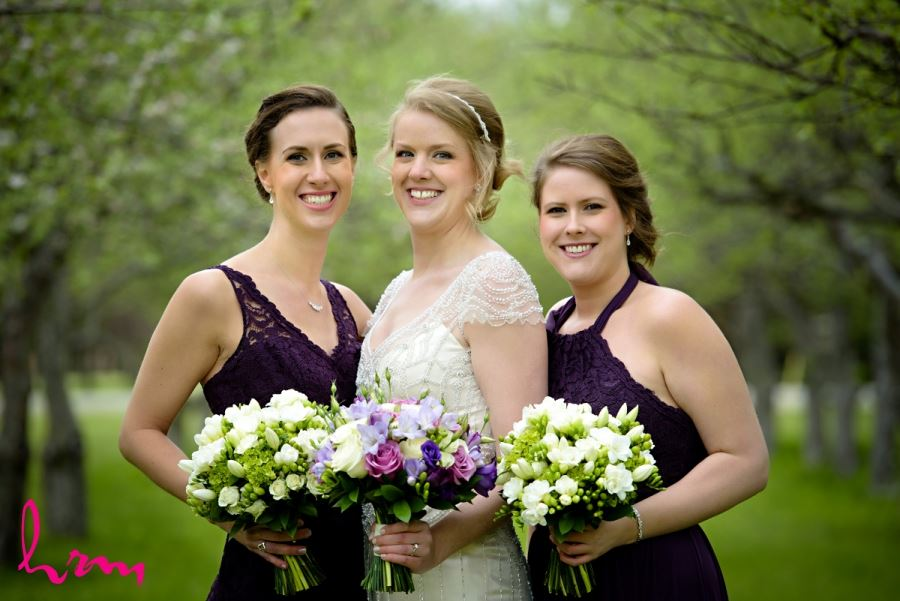 bride and bridesmaids with spring bouquets