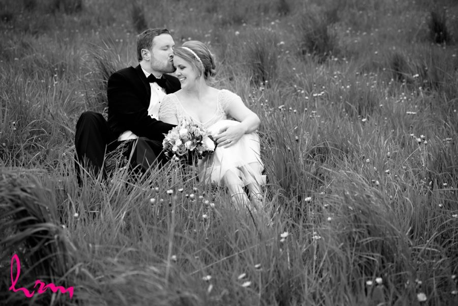 black and white bride and groom in field of grass