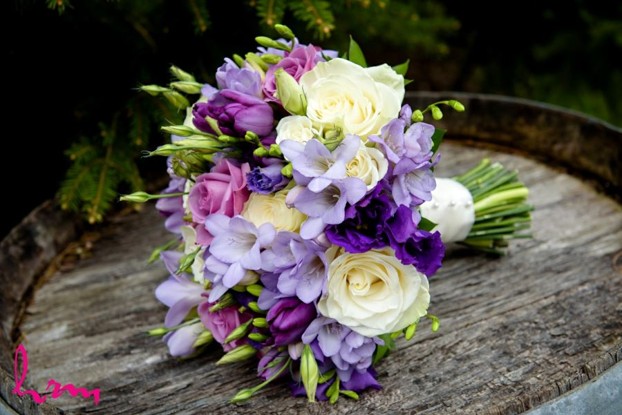 pretty spring bridal bouquet with purple pink white flower
