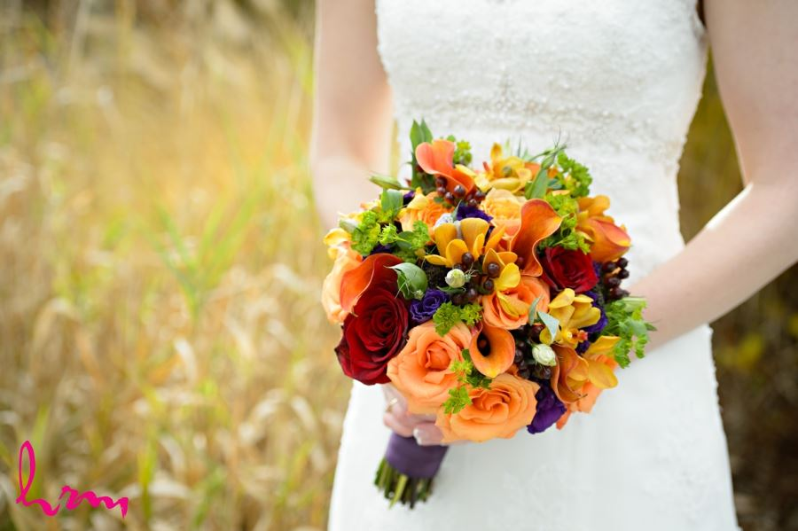 fall wedding bridal bouquet in red purple orange green