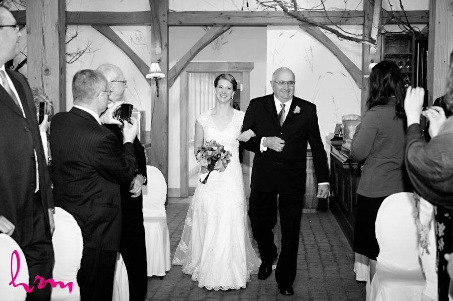 bride with father walking down aisle wedding ceremony
