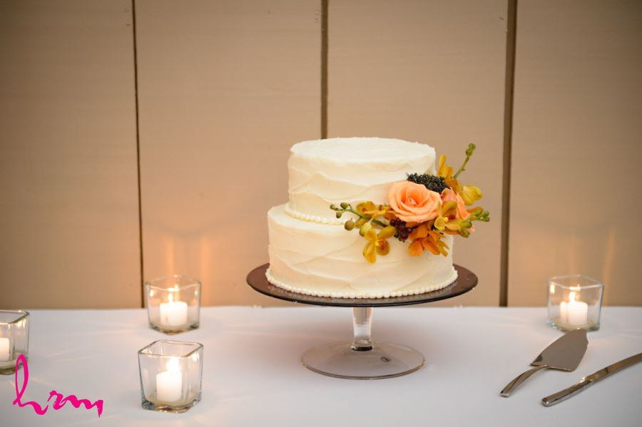 simple elegant two tier wedding cake with fall flowers