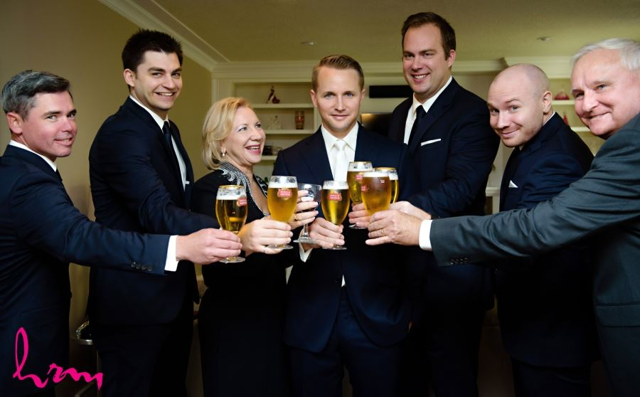 groomsmen cheers with beers