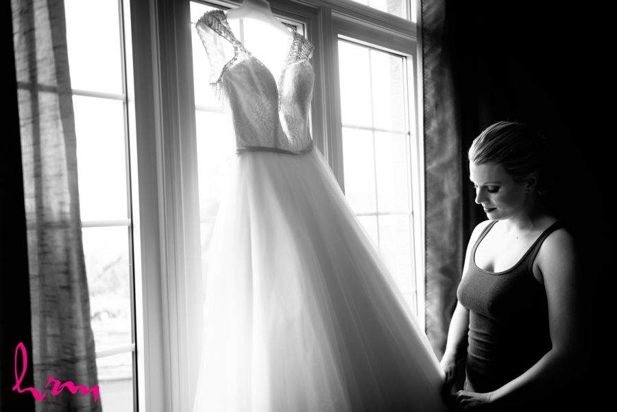 bride looking at dress
